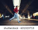 man in red hoodie running under ...   Shutterstock . vector #631323713