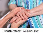 hands of young woman holding... | Shutterstock . vector #631328159