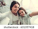 beautiful school girl and her... | Shutterstock . vector #631357418