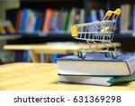 shopping cart on  library... | Shutterstock . vector #631369298