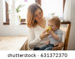 mother and son at the kitchen.... | Shutterstock . vector #631372370
