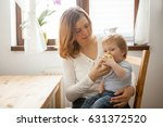 mother and son at the kitchen.... | Shutterstock . vector #631372520