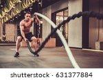 handsome muscular man is doing... | Shutterstock . vector #631377884