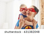 mother and her child playing... | Shutterstock . vector #631382048