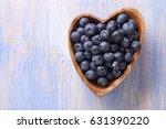 heap ripe sweet blueberries in...   Shutterstock . vector #631390220
