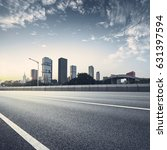 empty asphalt road of a modern... | Shutterstock . vector #631397594