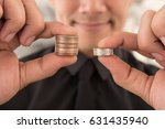 Small photo of businessman comparing return on investment