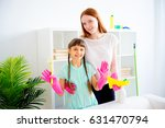 family cleaning house | Shutterstock . vector #631470794