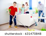 family cleaning house | Shutterstock . vector #631470848