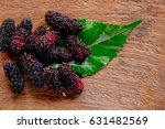 mulberry and  leaves on a... | Shutterstock . vector #631482569