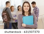 beautiful young college student ...   Shutterstock . vector #631507370