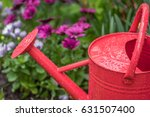 Closeup Of Red Watering Can In...