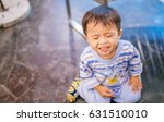 one sad little toddler boy... | Shutterstock . vector #631510010