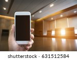 man's hand shows mobile... | Shutterstock . vector #631512584