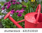 Bright Red Watering Can With...