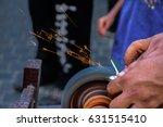 knife sharpener working with... | Shutterstock . vector #631515410
