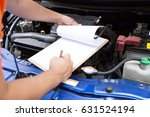 mechanic man check the car | Shutterstock . vector #631524194
