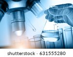 microscope with hand of... | Shutterstock . vector #631555280