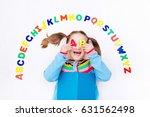 happy preschool child learning... | Shutterstock . vector #631562498