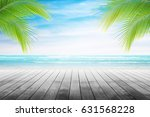 empty wooden table and palm... | Shutterstock . vector #631568228