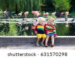 kids watch animals and birds at ... | Shutterstock . vector #631570298