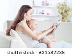 happy mother showing his year... | Shutterstock . vector #631582238