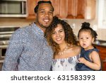 happy young family with their... | Shutterstock . vector #631583393