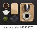top view of a black desk with... | Shutterstock . vector #631585070