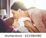 a nice girl and her mother... | Shutterstock . vector #631586480
