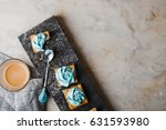 cakes with cream on a granite... | Shutterstock . vector #631593980