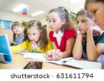 schoolchildren together study a ... | Shutterstock . vector #631611794