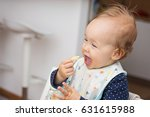 one year old baby girl feeding... | Shutterstock . vector #631615988