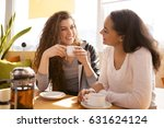 shot of cheerful girlfriends... | Shutterstock . vector #631624124