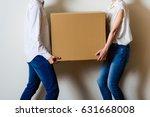 men and women couple carrying a ... | Shutterstock . vector #631668008