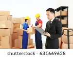 manager with clipboard standing ... | Shutterstock . vector #631669628