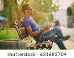 black guy sitting in old city... | Shutterstock . vector #631683704
