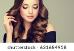 brunette  girl with long  and ... | Shutterstock . vector #631684958
