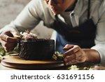 baker man using flowers... | Shutterstock . vector #631691156