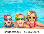 Happy Children In The Swimming...
