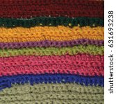 Small photo of Knitted fine wool garment colorful stripes background natural texture yellow beige claret pink blue green scarf macro closeup, large detailed textured knit vertical pattern, horizontal woolen garment
