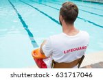 Rear view of lifeguard sitting...