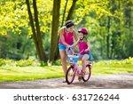 child riding bike. kid on... | Shutterstock . vector #631726244