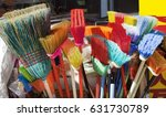 colorful brooms for sale. | Shutterstock . vector #631730789