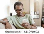 indoor portrait of fashionable... | Shutterstock . vector #631790603