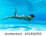 female snorkeler with bikini... | Shutterstock . vector #631836503