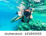 Woman Underwater Snorkeling...
