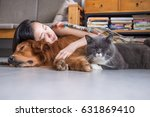 Stock photo girls sleep with cats and dogs 631869410