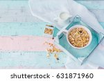 bowl of oat flakes and milk on...   Shutterstock . vector #631871960