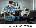 father teaching his son to play ... | Shutterstock . vector #631873844