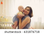 happy mother with laughing...   Shutterstock . vector #631876718